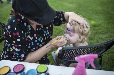 Elena Baker gets her face painted. | WILLIAM CAMARGO/Staff Photographer