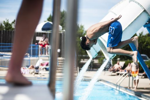 A teenager takes a dive into the pool. | WILLIAM CAMARGO/Staff Photographer