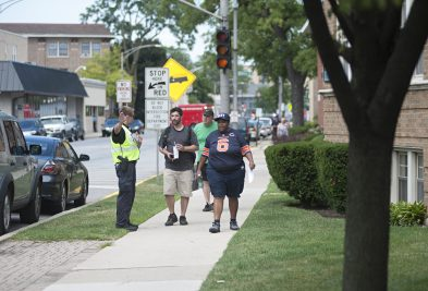Forest Park police escort civilians off Desplaines Avenue on Monday afternoon around 3 p.m., after a grenade was brought in by a resident to the police station.