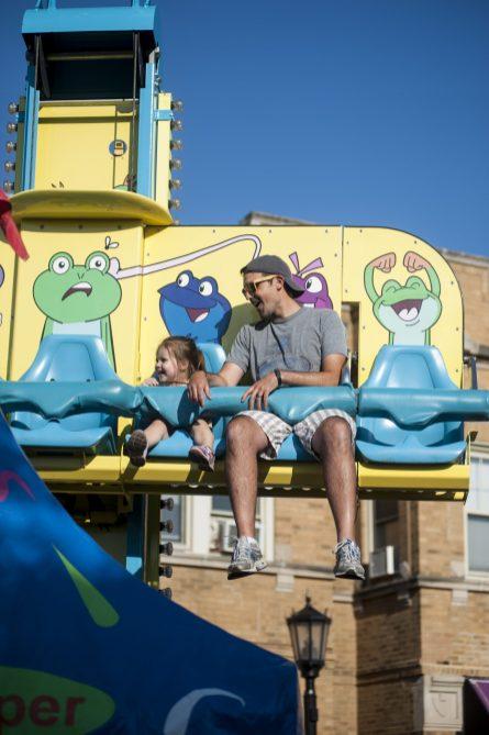 Justin and Ellie Erkfritz-Gay enjoy a carnival ride.   William Camargo/Staff Photographer
