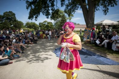 Pickles the Clown leads a trivia contest during the International Clown Week Celebration at Woodlawn Cemetery in Forest Park last Sunday. | William Camargo/Staff Photographer