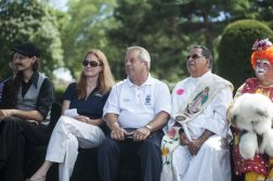 Forest Park Mayor Anthony Calderone watches performers with other guests. | William Camargo/Staff Photographer