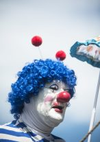 Polyester the clown watches performers during the International Clown Week Celebration at Woodlawn Cemetery in Forest Park on August 7. | William Camargo/Staff Photographer
