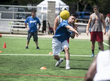 Ronald Moreno throws a ball towards a Currie Motors employee during a dodgeball game in Forest Park last Saturday. | William Camargo/Staff Photographer