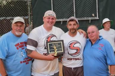 Park District Executive Director Larry Piekarz, left, awards the trophy.   Courtesy Torey A. Earl