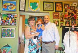 Erika and John Osborn with their daughter, Victoria. | JACKIE SCHULZ/Contributor
