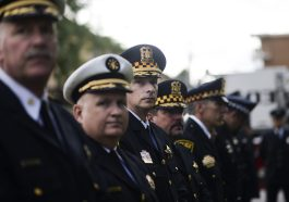 Forest Park Police Chief Tom Aftanas (second from left) stands with other officers during a memorial dedication to fallen officers and firefighters in Forest Park in 2015. | File photo