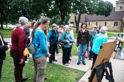 Attendees gather in front of the Haymarket Memorial at Forest Home Cemetery before starting their tour. | William Camargo/Staff Photographer