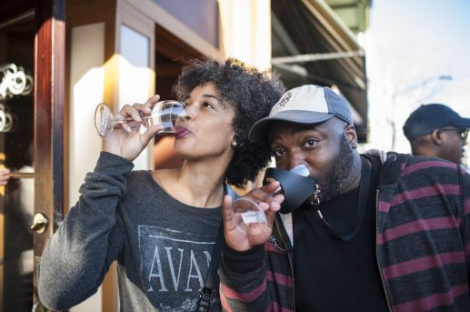 Andriana Bouldin and William Smith enjoy some wine on Madison Street during the annual Wine Walk/Shop event in Forest Park on Saturday afternoon, Nov. 3. | William Camargo/Staff Photographer