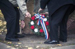 Mayor Anthony Calderone and a veteran lay a commemorative wreath. | William Camargo/Staff Photographer