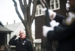 Michael Thompson salutes during the national anthem. | William Camargo/Staff Photographer