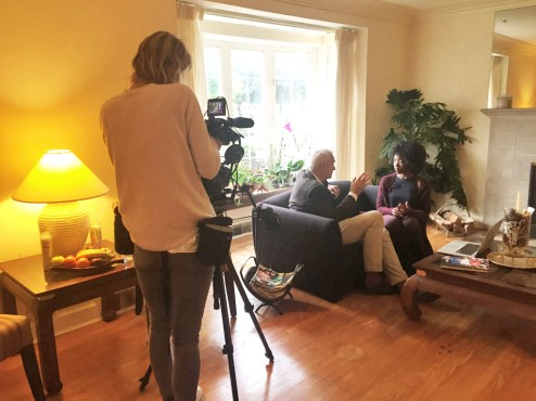 Kelauni Cook with British TV journalist/celebrity Jon Snow.   Courtesy Kelauni Cook