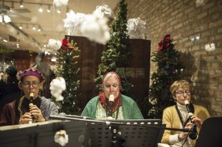 A small group of recorder players serenaded shoppers with holiday jingles. | William Camargo/Staff Photographer