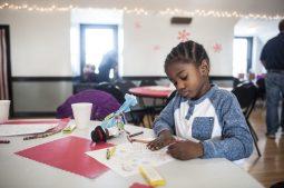 Malik Mullins draws and colors. | William Camargo/Staff Photographer