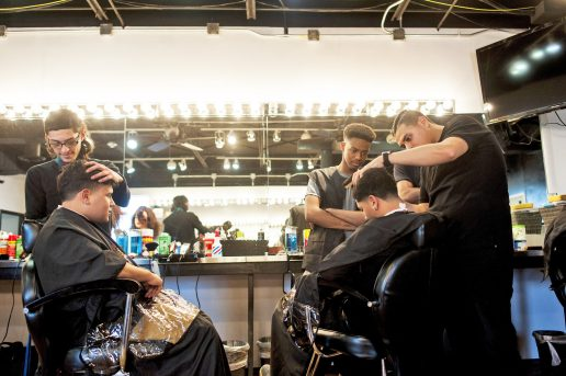 Octavio G?lvez and Ricardo Villanueva work on their classmates' hair while Justin Simmons supervises on Feb. 4 at the Erskine Reeves Barber Academy.   File photo