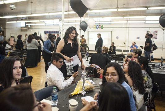 Valedictorian Andrea Lopez joins her family after receiving her award and being able to graduate from Proviso East Evening School on May 19.   File photo