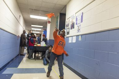 Carter Leonard, 8, tests his paper plane at the Science in the Neighborhood event at Forest Park Middle School on Friday night, Feb. 10. | William Camargo/Staff Photographer