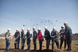 Officials gather for the ceremonial shovel brigade marking the beginning of construction on the Family Rec Center at The Park, April 1.   William Camargo/Staff Photographer