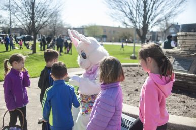 The Easter Bunny chats with children during the annual Easter Egg Hunt at The Park last Saturday morning. | William Camargo/Staff Photographer
