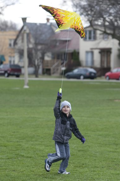 Cian Thiesse, 5, gets his kite airborne during a kite-flying event at the Park in Forest Park, Saturday, April 13, 2013. Saturday's winds make for perfect kite-flying conditions. (David Pierini/staff photographer)