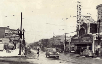 This photo (from the 1930's)of Madison St. looking east is Mader's Tire shop (left) and Albright's (right), where Lindbergh could be seen hanging around Forest Park in the 1920's.