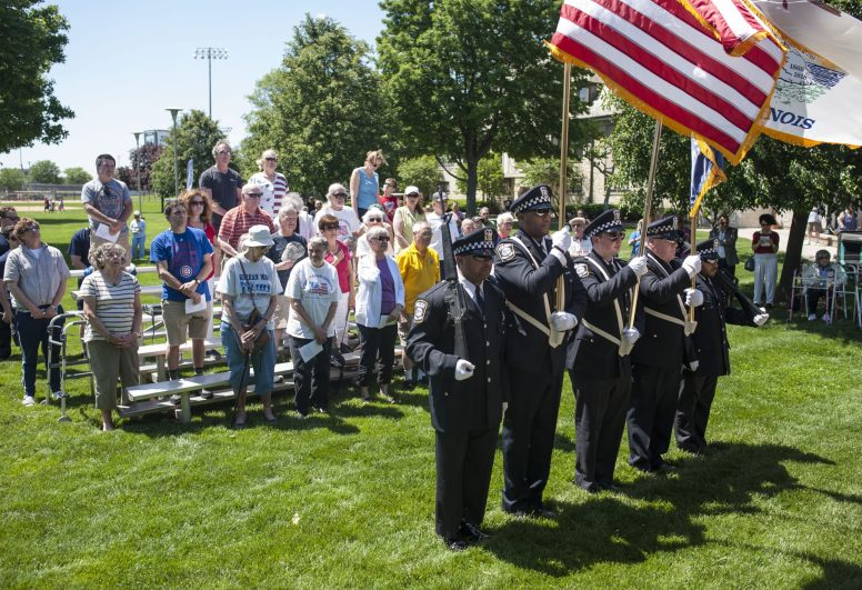 Police and military personnel prepare to post the flags during the Memorial Day ceremony in Forest Park on Monday at The Park. | William Camargo/Staff Photographer