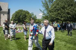 Forest Park Mayor Anthony Calderone and Sergeant Knute Weick take the memorial wreath to the memorial landmark. | William Camargo/Staff Photographer
