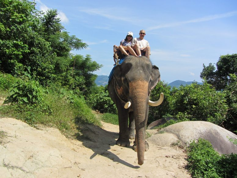 Anthony and Pim on an elephant in Thailand. | Courtesy Anthony