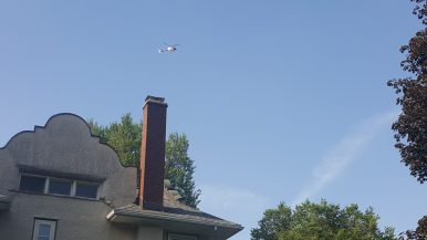 A helicopter circles the areas just south of Madison Street and west of Oak Park Avenue as police searched for a Forest Park carjacking suspect. (Photo by Timothy Inklebarger|Staff)