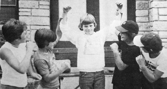 Ten year-old Ronald Dalton, a Field-Stevenson School student, celebrates breaking the previous world record by wearing his roller skates for 16 days. | Photo courtesy Forest Park Historical Society