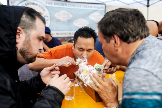 Members from team Bullhead Tank Walrus devour 21 scoops of ice cream during Brown Cow's annual Trough Eating Contest on July 10 on their way to victory.   William Camargo/Staff Photographer