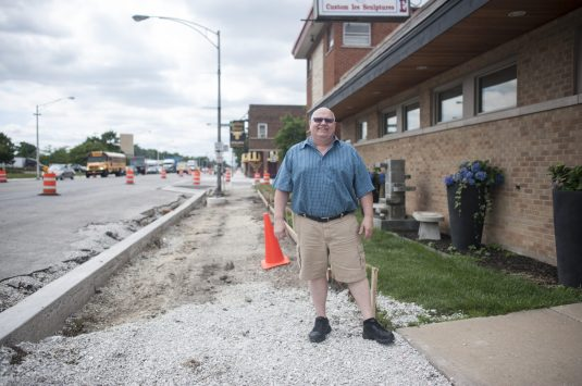 Jim Nadeau stands in front of his business, Nadeau's Ice House, on Roosevelt Road on July 14. The thoroughfare is in the midst of a makeover.   William Camargo/Staff Photographer