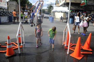Children cooling off during a hot Saturday. | William Camargo/Staff Photographer