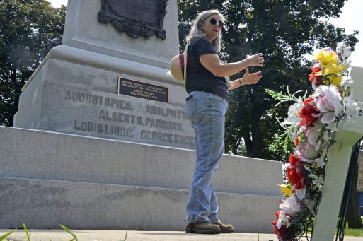 Amy Binns-Calvey discusses the importance of the monument with attendees on Saturday, Aug. 5, during a tour of the Haymarket Martyrs' monument and Radical Row at Forest Home Cemetery in Forest Park.   Alexa Rogals/Staff Photographer