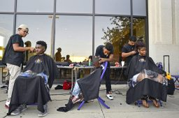 Students with Erskine Reeves Barber Academy give free hair cuts to students. | Alexa Rogals/Staff Photographer