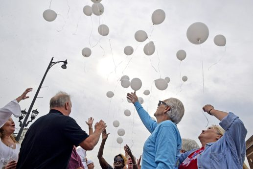 Attendees release white balloons into the air on Saturday, Aug. 26, during the 40th anniversary celebration at Starship Restaurant on Madison Street in Forest Park. | Alexa Rogals/Staff Photographer