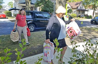 Kelly Rice, left, and Carol Novak, both of Forest Park, carry donated items to the yard on Sept. 2, at the Novak's home on Hannah Avenue in Forest Park.   Alexa Rogals/Staff Photographer