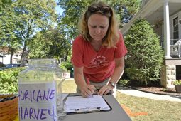 Kelly Rice, of Forest Park, donates cash and items.   Alexa Rogals/Staff Photographer