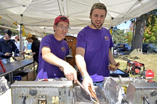 Daniel Aguilar, left, of Naperville, and Hunter Knill, of Joliet, make deep fried candy bars. | Alexa Rogals/Staff Photographer