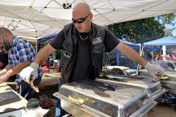 Brian Vanzeyl, of Lombard, grabs a sample of ribs. | Alexa Rogals/Staff Photographer