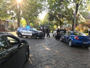 Police from Forest Park and the West Suburban Major Crime Task Force on the scene of a death investigation in the 7700 block of Adams Street in Forest Park on Sept. 20. (Michael Romain|Staff)