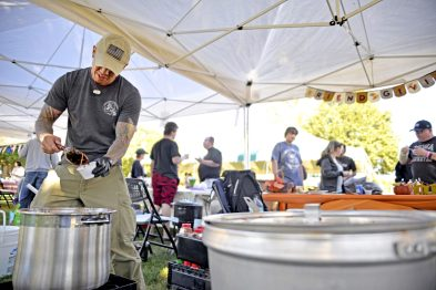 Chris Chin scoops up a sample of chili on Saturday, Sept. 30, during the 2nd annual Chili and Beer Fest at the Park District of Forest Park. | Alexa Rogals/Staff Photographer