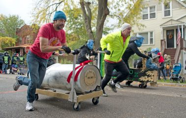 The Forest Park Review team, left, race the Riveredge Hospital team on Saturday, Oct. 28, 2017, during the 6th annual Forest Park Chamber of Commerce Casket Races on Beloit Avenue, south of Madison Street in Forest Park, Ill. (ALEXA ROGALS/Staff Photographer)