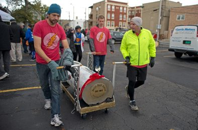 The Forest Park Review team makes their way to the street on Saturday, Oct. 28, 2017, during the 6th annual Forest Park Chamber of Commerce Casket Races on Beloit Avenue, south of Madison Street in Forest Park, Ill. (ALEXA ROGALS/Staff Photographer)