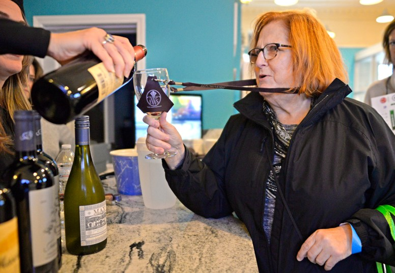 Sandra Luckins, of Forest Park, tries a sample of wine at Twisted Cookie on Saturday, Nov. 4, 2017, during the annual Wine Walk and Shop at participating businesses on Madison Street in downtown Forest Park, Ill. More than 15 businesses participated in the event and most of those shops had small bites and snacks with the wine. ALEXA ROGALS/Staff Photographer