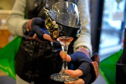 A participant holds their wine glass with a decorated wine glass neck holder, on Saturday, Nov. 4, 2017, during the annual Wine Walk and Shop at participating businesses on Madison Street in downtown Forest Park, Ill. ALEXA ROGALS/Staff Photographer