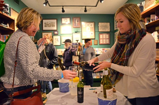 Kristina Burke, right, of Joliet, serves samples of wine to participants at Centuries and Sleuths Bookstore on Saturday, Nov. 4, 2017, during the annual Wine Walk and Shop at participating businesses on Madison Street in downtown Forest Park, Ill. ALEXA ROGALS/Staff Photographer