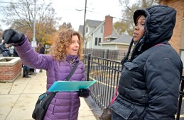 Julianne Bonwit, left, asks Lawanda Hewitt to sign a petition for a stop sign to be installed at the intersection of Jackson Boulevard and Hannah Avenue before preschool let out at Garfield Elementary School in Forest Park. Bonwit said it will make the street safer for the children and that the stop sign will allow for a crossing guard to be there.   Alexa Rogals/Staff Photographer
