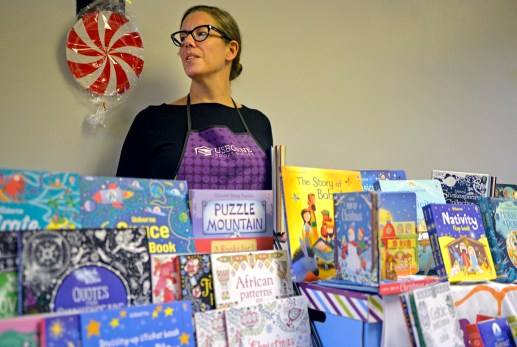 Bee Kirchgatterer, an educational consultant with Usborne Books and More stands behind a table stocked with children's books. | Alexa Rogals/Staff Photographer