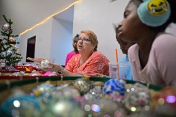 Karen Love, of Chicago talks about her decorated and custom made ornaments she has for sale. | Alexa Rogals/Staff Photographer